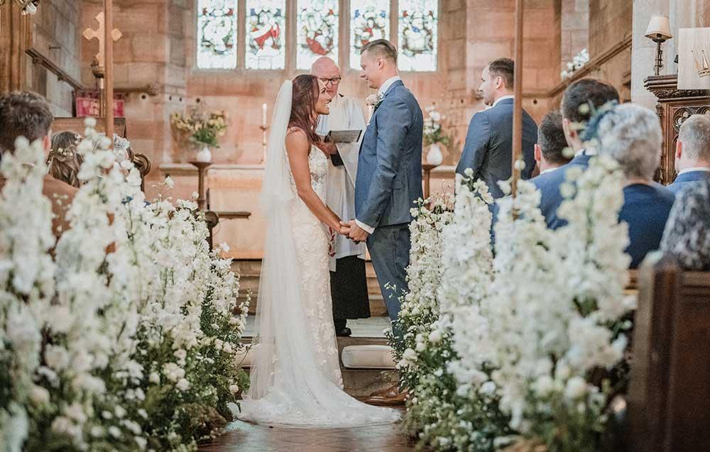 Bride and groom at St Peter's church at Arley