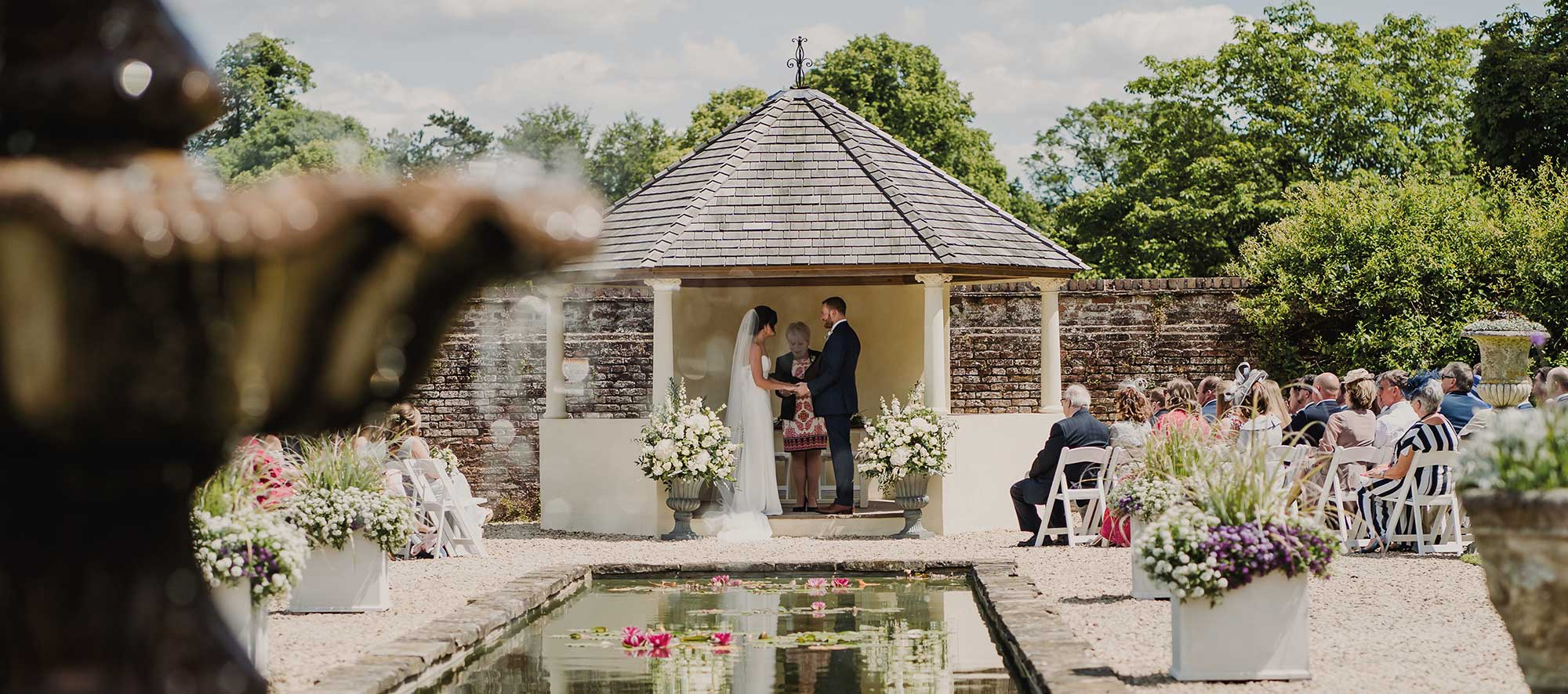 Bride and groom in Italian Gardens at Arley House